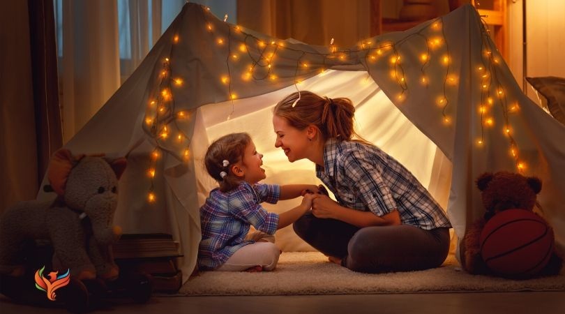 A mom with her kid in a tent