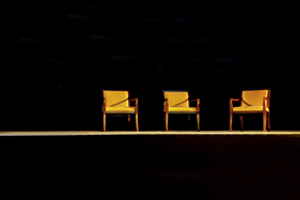 3 chair in dark room