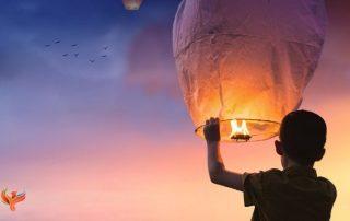a boy with hot balloon